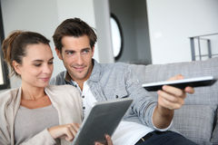 Young couple in sofa watching tv Stock Photo