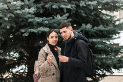 A young couple with sparklers in the hands in the city park stock photo
