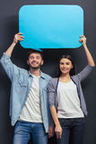 Young couple with speech bubbles Royalty Free Stock Photo