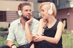 Young couple spend time together with music. stock photo