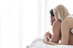 Young couple spending quality time in bed Stock Photos