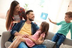 Young couple spending time with children. At home. Happy family Royalty Free Stock Images