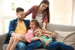 Young couple spending time with children at home. Happy family royalty free stock photo