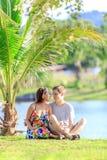 Young couple spending time in a tropical garden Royalty Free Stock Photos