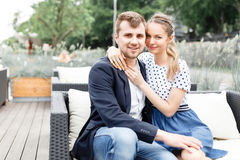 Young couple spends time on the couch Stock Photos