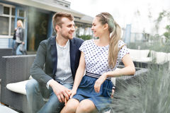 Young couple spends time on the couch Royalty Free Stock Photos