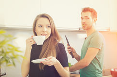 Young couple spends time together in the kitchen Stock Photo