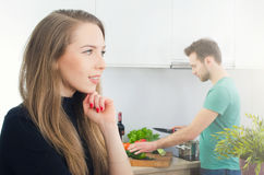 Young couple spends time together in the kitchen Stock Image