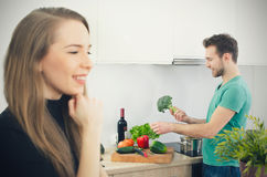 Young couple spends time together in the kitchen. Lifestyle couple kitchen cooking home happy breakfast young concept Royalty Free Stock Photos