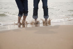 Young Couple Splashing in the Waves Stock Photo