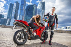 Young couple on a sports bike on the background of the city skyl Stock Photo