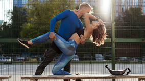 Young couple in sportwear after jogging having a rest royalty free stock image