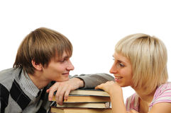 Young couple with stack of books Stock Photo