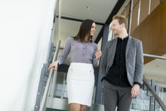 Young couple on the stairs in office Royalty Free Stock Image