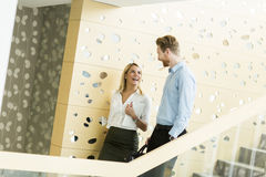 Young couple on stairs in office Stock Images