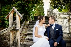 Young couple on the stairs in the park. Royalty Free Stock Image