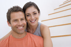 Young couple on stairs, smiling, portrait Stock Photo