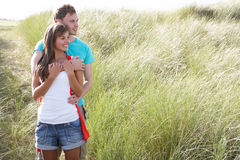 Young Couple Standing Amongst Dunes. Romantic Young Couple Standing Amongst Dunes Royalty Free Stock Photos
