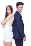 Young couple standing back to back Stock Images