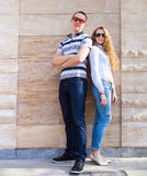 Young couple standing back to back Royalty Free Stock Images