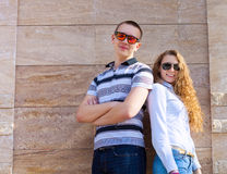 Young couple standing back to back Stock Photography