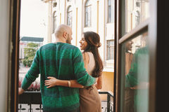 Young couple standing at the balcony of the hotel room Stock Images