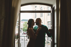 Young couple standing at the balcony of the hotel room Royalty Free Stock Photos