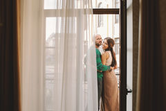 Young couple standing at the balcony of the hotel room Stock Photo