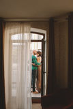 Young couple standing at the balcony of the hotel room Stock Image