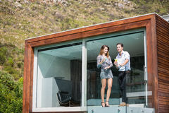 Young couple standing in balcony at resort royalty free stock images