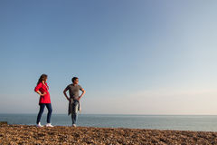 Young couple standing at the beach in UK Royalty Free Stock Photo