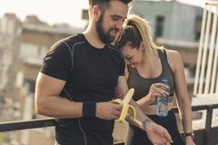 Couple resting after a workout stock image