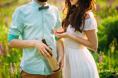 Young couple standing close to each other holding wine royalty free stock image