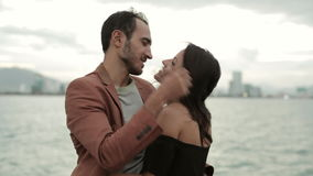 Young couple standing at deck of drifting vintage boat, talking and hugging stock footage