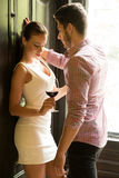 A young couple standing at the door Stock Photos