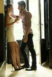 A young couple standing at the door Royalty Free Stock Image
