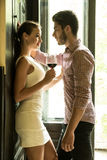 A young couple standing at the door Stock Photography