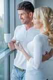 Young couple standing enjoying the view Stock Photography