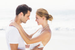 Young couple standing face to face and romancing Stock Photos