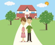 Young couple standing in front of their house Stock Image