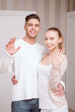 Young couple standing and greeting Royalty Free Stock Photos
