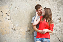 Young couple is standing grunge wall Stock Images