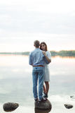 Young couple standing by a lake Stock Images