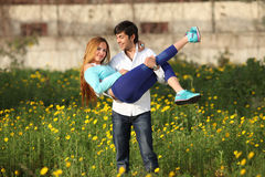Young couple standing in meadow Royalty Free Stock Photography