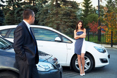 Young couple standing near the car Stock Photos