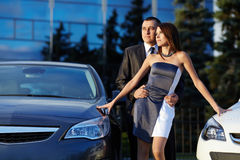 Young couple standing near the car Stock Images