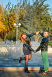 Young couple standing near fountain Royalty Free Stock Photo