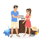 Young couple standing near luggage and using tablet pc to watch photos from their holiday Royalty Free Stock Photo