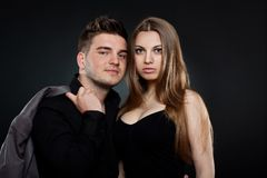 Young couple standing next to each other Stock Photo