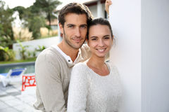 Young couple standing outdoors smiling Royalty Free Stock Photography